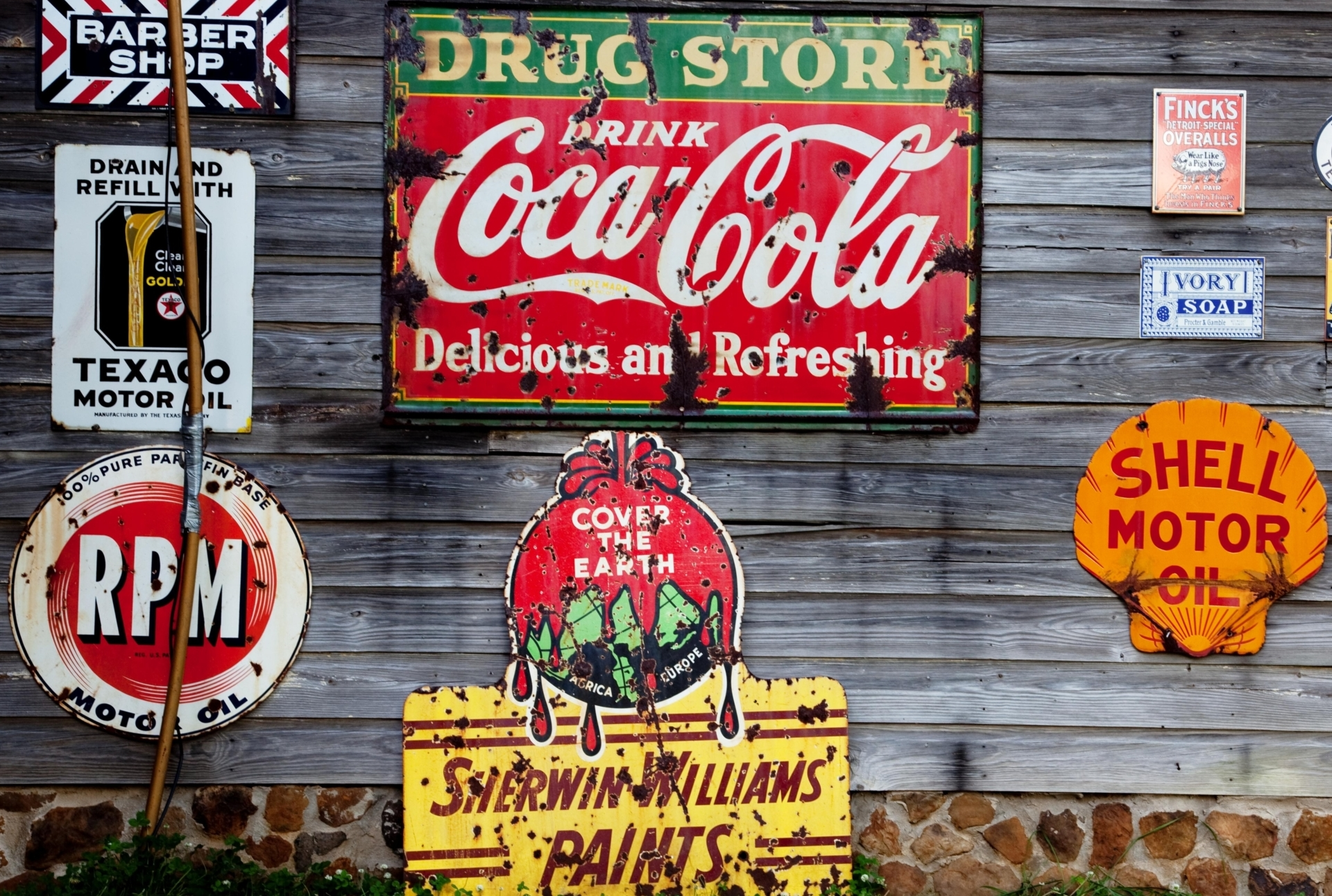 advertising of different products on wooden wall