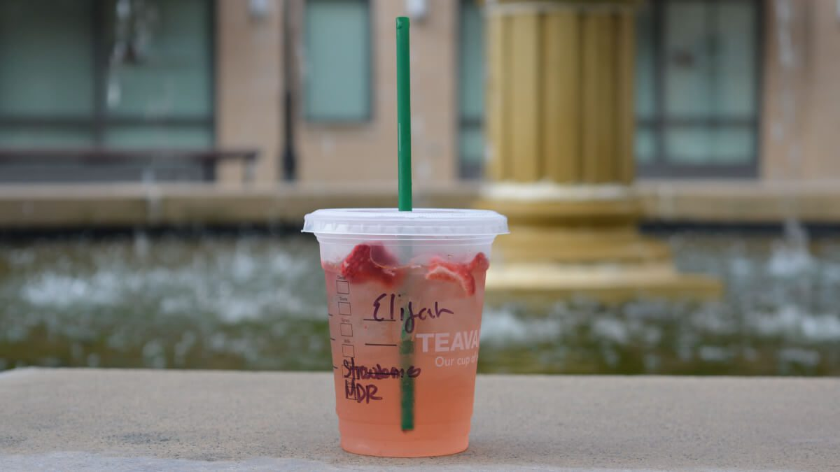 starbucks refresher sitting on the road curb in spring
