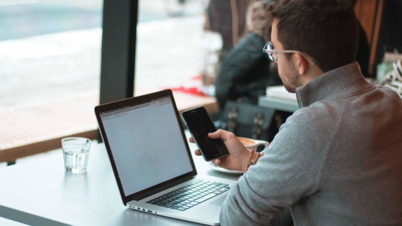 man sitting at computer trying to get more google my business reviews