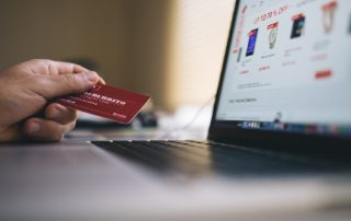 Person with credit card on website shopping a website with an SSL Certificate