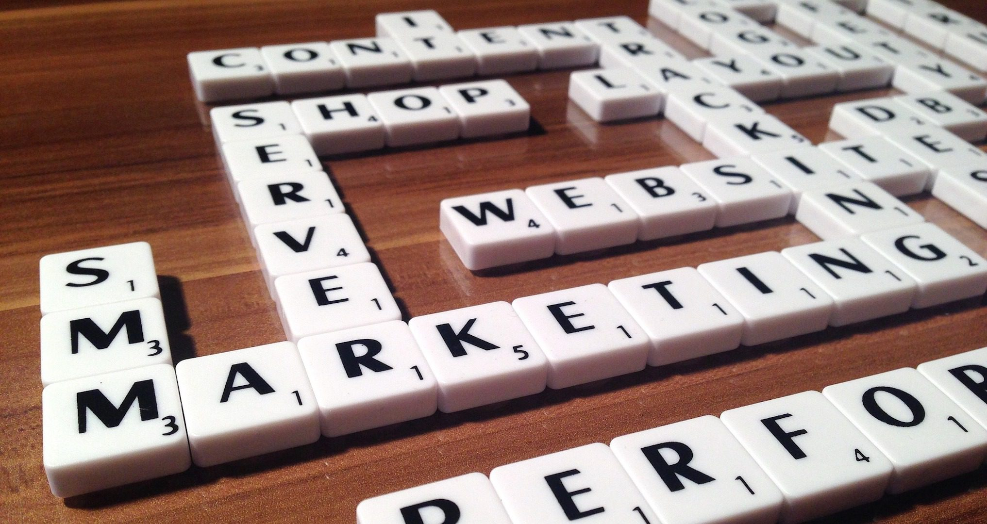 scrabble letters spelling out web design and development words