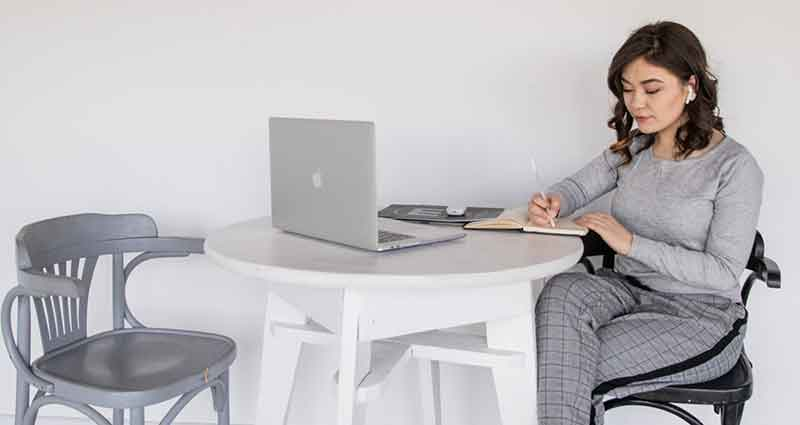 woman working on laptop concentrated