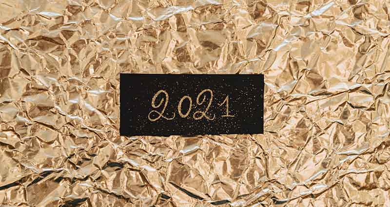 2021 on a gold background